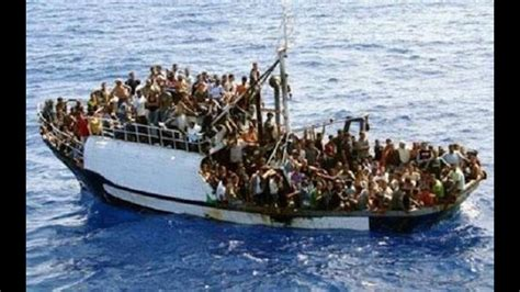 overcrowded refugee boat thousands of syrian refugees rescued by italian coast