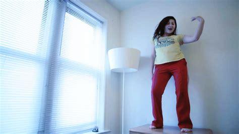 girl dancing in bathroom gorgeous blonde girl having fun in a bathroom singing hit