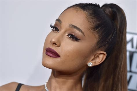 new haircut story ariana grande s long hair channels rapunzel in new video