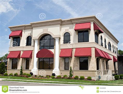 red awnings tan building with red awnings royalty free stock photos