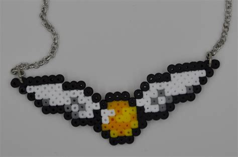 perler bead necklace golden snitch harry potter inspired perler bead necklace