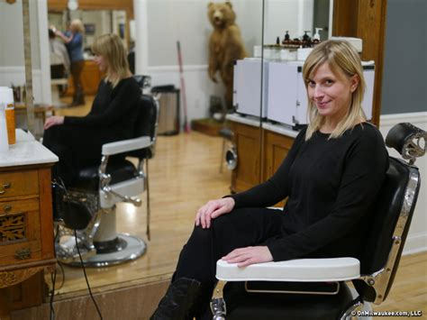 female in barber chair getting buzzcut stag barbershop adds chairs room to grow onmilwaukee