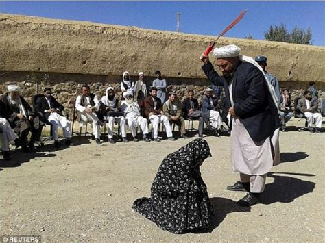 crowd  men   afghan woman receives  lashes