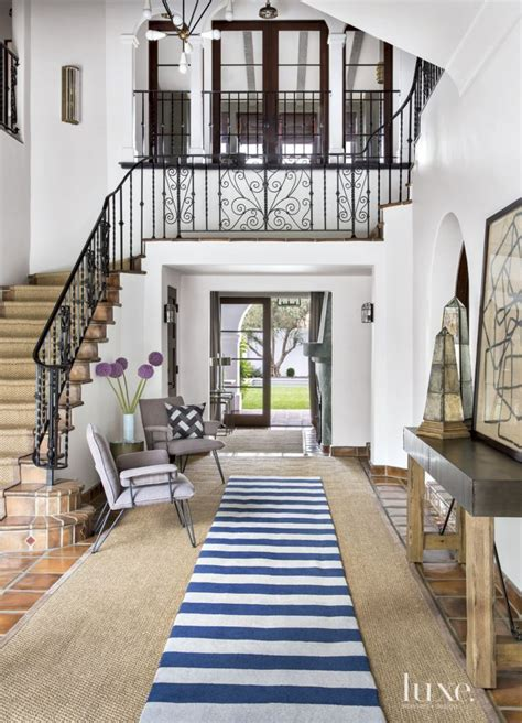 home design exterior and interior colonial neutral entry with purple chairs luxe