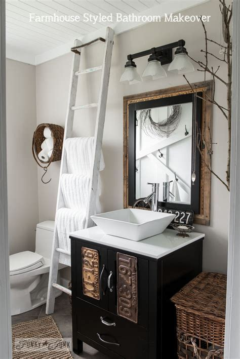 Salvaged farmhouse bathroom makeover with vintage trimFunky Junk Interiors