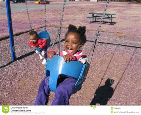 kids on swing children on swings royalty free stock images image 1544489