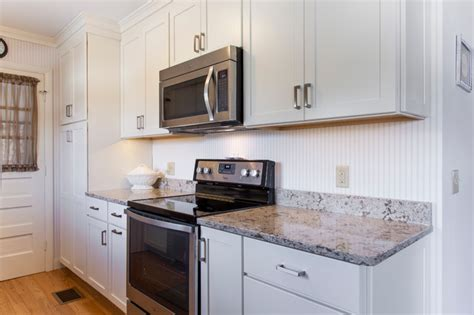 Galley Kitchen White Cabinets White Painted Shaker Galley Kitchen With Quartz Countertops Transitional Kitchen Other