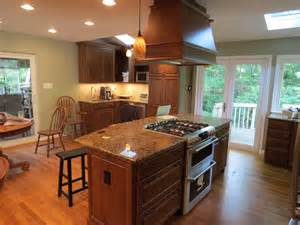 Kitchen Island With Stove Top Wooden Kitchen Island With Modern Stove Top On Glossy