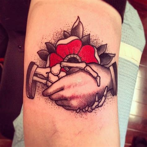 shaking hands tattoo taken with instagram at idle ink