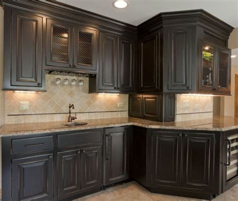 black cabinet kitchens 25 best ideas about dark wood cabinets on pinterest