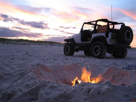 jeep beach amazing shot of a modified jeep tj by a fire on the beach