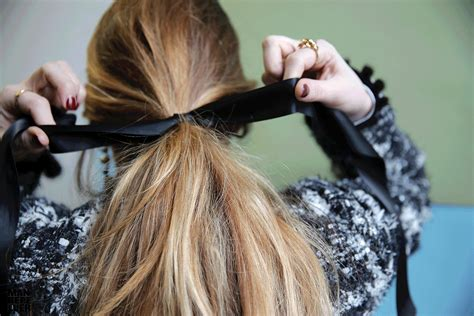 bow in her hair and rear view to try the choker that is also a hair bow man repeller