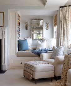 Huge pillows warm throws and a beautiful pair of sconces