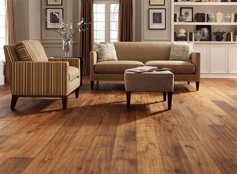 laminated walnut wooden floor and brown sofas with small living room design with wide plank distressed wood