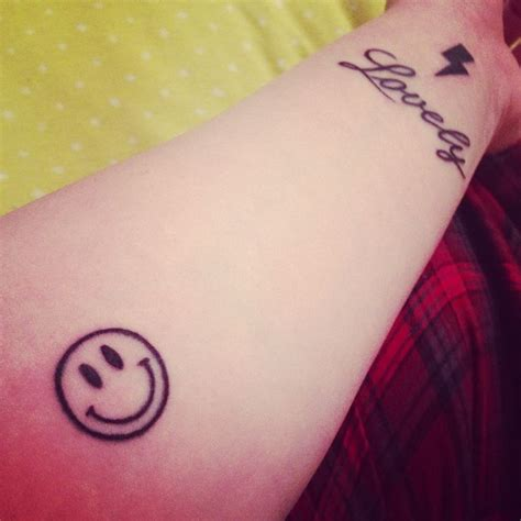 smiley tattoo my new tattoos i had the lovely and smiley fixed and