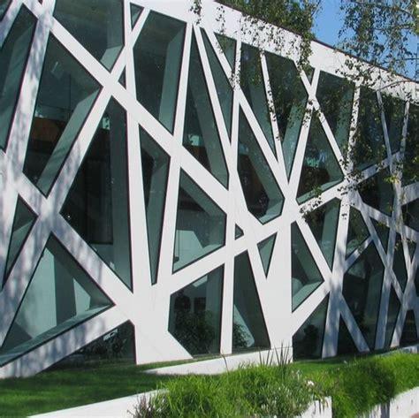 Mur rideau à structure aluminium dissimulée sous vitrage   REYNAERS ALUMINIUM