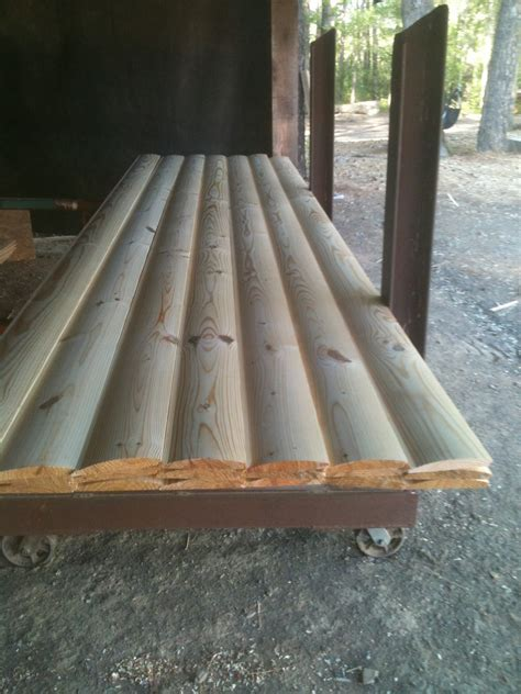 Knotty yellow pine and Red Cedar log siding, v groove