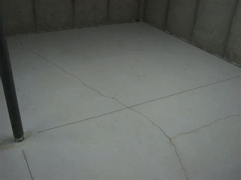 Basement Floor Cracks in Waukesha: Causes & Fixes