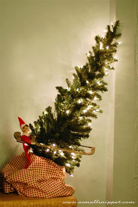 elf on the shelf is cutting down a christmas tree
