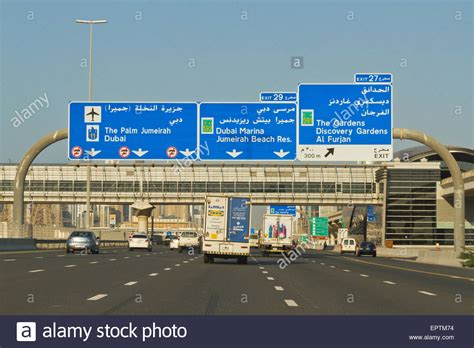 emirates road road signs and traffic on sheikh zayed road dubai united