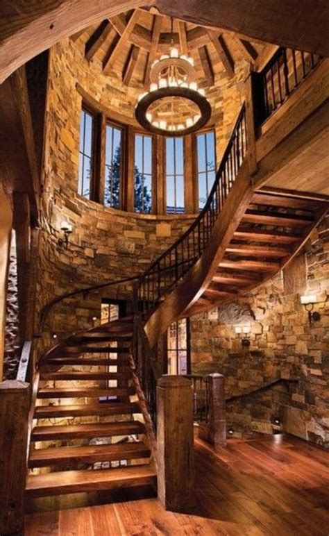 massive wooden spiral staircase in large stone stairway