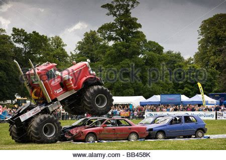 monster truck farm show monster trucks crushing old cars at a farm show