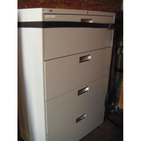 Locking Lateral File Cabinet Hon 4 Drawer Lateral Locking Filing Cabinet Allsold Ca Buy Sell Used Office Furniture Calgary