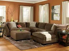 brown theme sectional living room ideas with hardwood