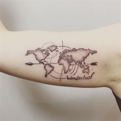world wide tattoo map of the world compass on arm in black and grey