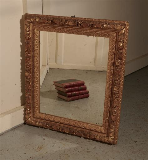 early  century carved wood gilt rococo wall mirror