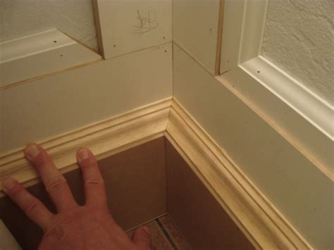 how to install baseboard trim in bathroom 11 how to miter baseboard molding the joy of moldings com