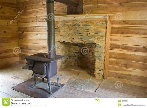 Log Cabin With Wood Burning Stove by Wood Stove In Log Cabin 4913 1s Stock Photo Image 1200208