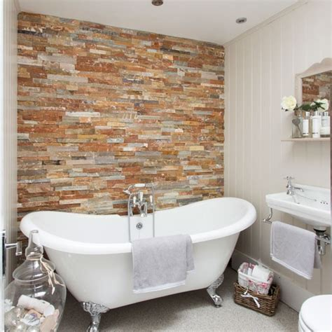 a stylish bathroom with a brick feature wall bathroom