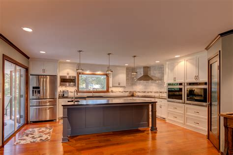 white kitchen with gray island content in a cottage modern white kitchen with gray island dovetail