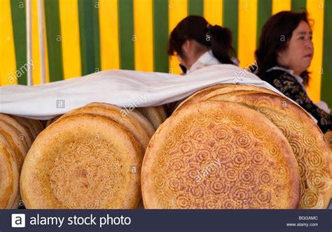 uzbek bread stock photos royalty free images vectors bread for sale at chorsu bazaar tashkent uzbekistan