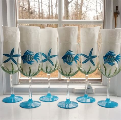 spray painting eyeglass frames fish and starfish turquoise and blue painted wine