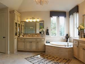 master bath cabinets in bone white with glass door