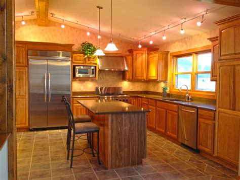 cabinet appliances with brown stained wooden hickory merillat hickory cabinets viatera quartz tops wac