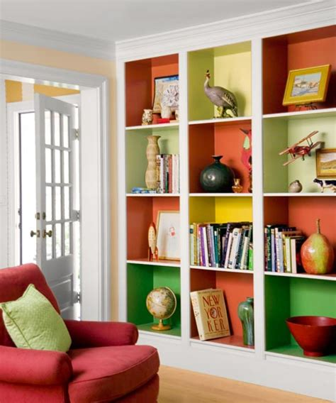 mix and match inside bookcases with a color pop this house
