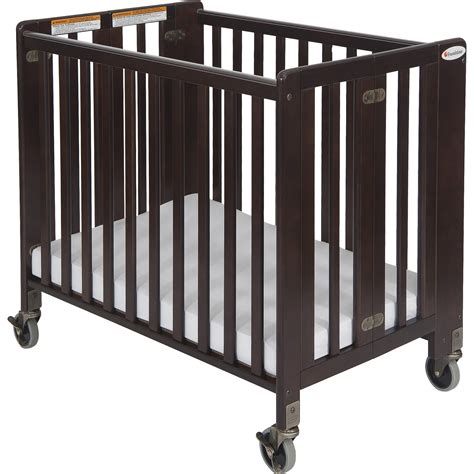 Foundations Hideaway Folding Crib by Foundations Hideaway Storable Wood Convertible Crib With