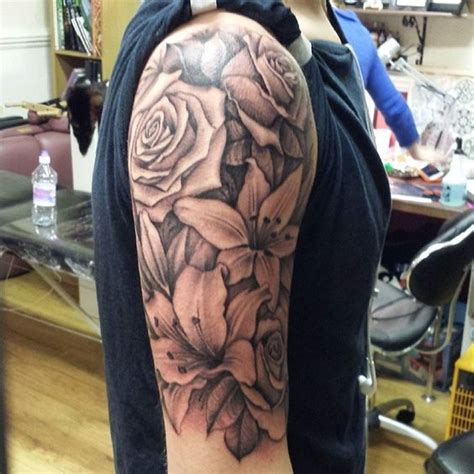 rose and lily tattoos sleeve style and wraps on