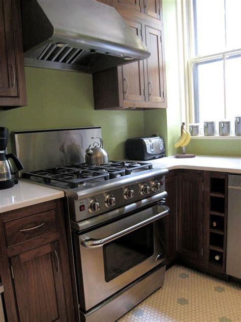 Green Kitchen Walls Brown Cabinets Mix Of Brown Cabinet Stainless Steel Appliance And