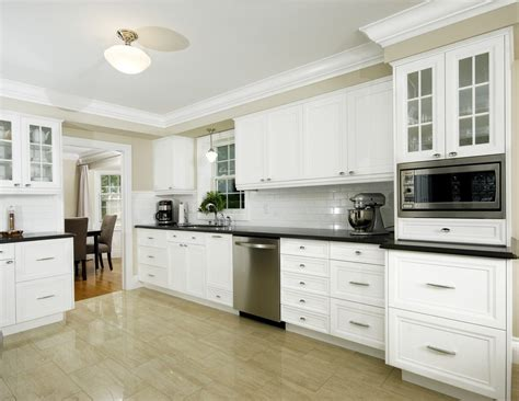 crown moulding in kitchen cabinets white kitchen cabinets with wood molding white chair