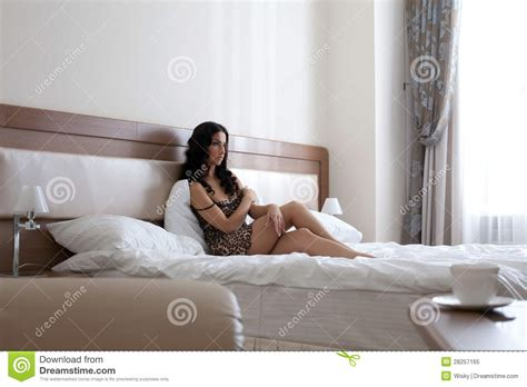 what women want in the bedroom beautiful brunette woman in bedroom royalty free stock