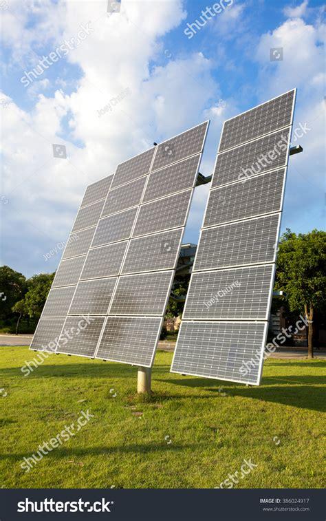 solar panels on green grass stock photo 386024917