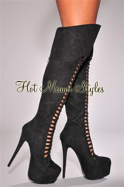 black caged knee high heel boots
