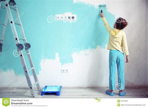 painting walls child painting the wall stock image image 37670531