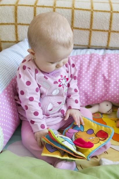 baby pictures book baby looking at the book free stock photo domain