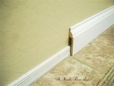 install wide baseboard molding  existing narrow baseboard     home