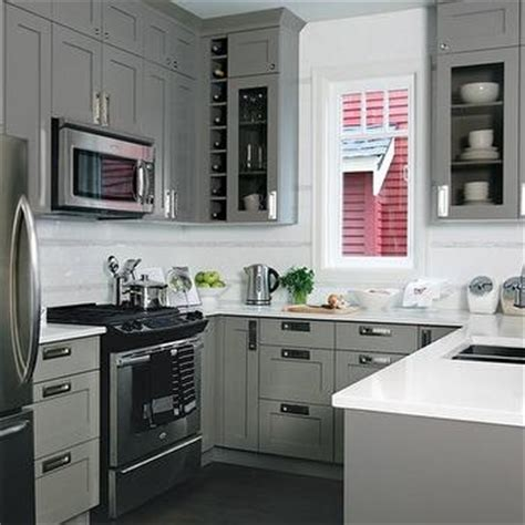hood range small u shaped kitchen designs white tile backsplash built in wine rack contemporary kitchen buckingham